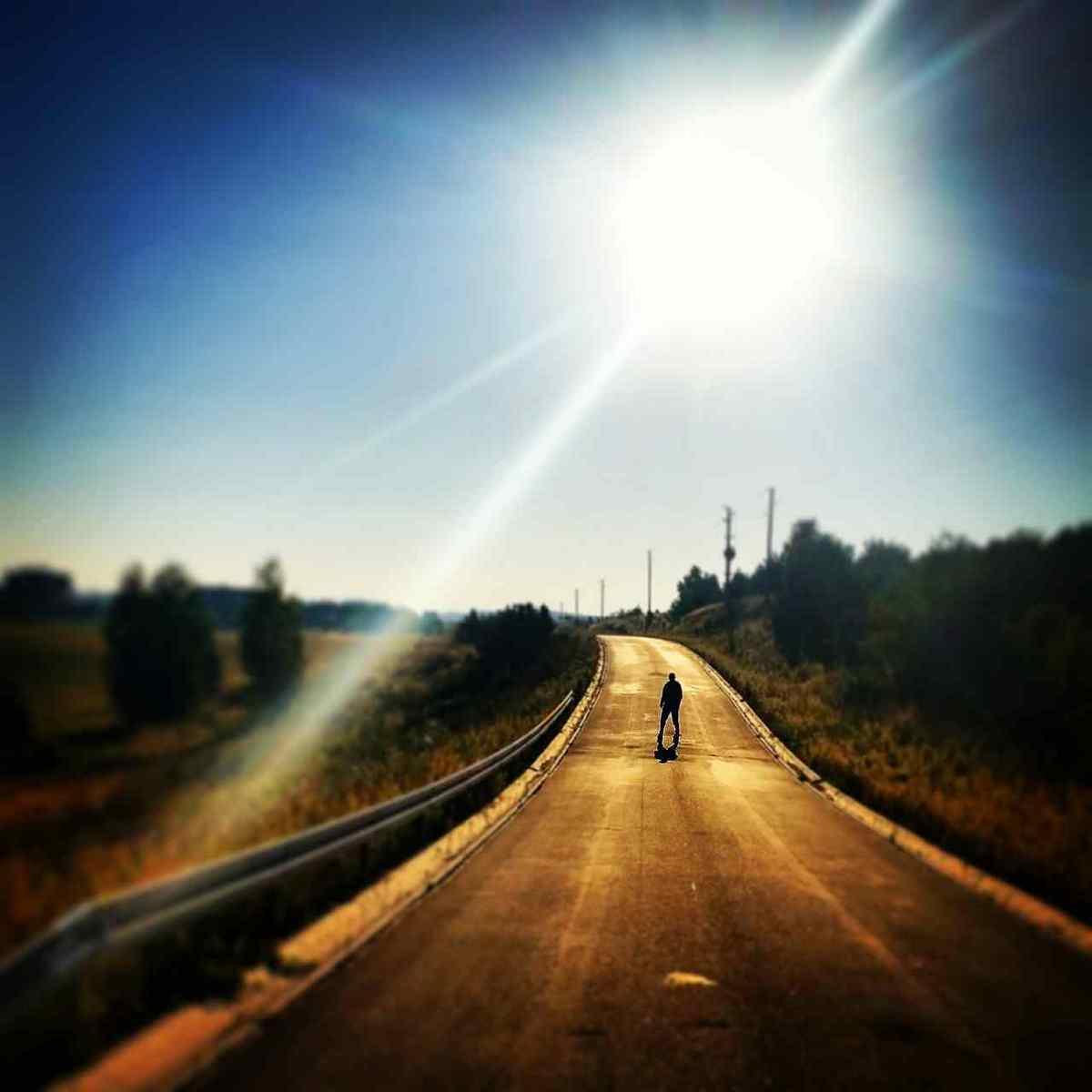 man on road analogy of life journey